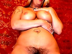 Slutty blonde Joclyn Stone does a kinky striptease and rides a cock with her natural hairy pussy