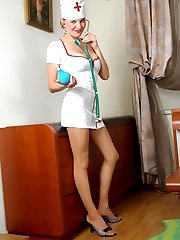 Nasty nurse in barely visible tights playing lesbian games with her patient