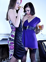 Hot lipstick lesbo in lacy stockings uses a strapon rod after a few drinks