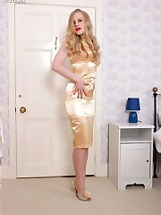 In shimmering gold satin, racy blonde Lucy enters the bedroom in lovely vintage FF hosiery and...