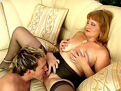 Lusty old lady-boss bares her tits and spreads legs interviewing a new guy