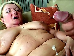 After fucking her in a couple of positions he removes his dick and cums on her granny tummy