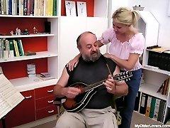 Older man entertains a sweet babe