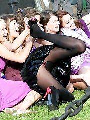 Merry girls show upskirts outdoor