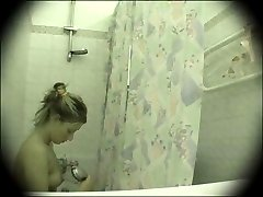 Delicious young lass enjoys the cool shower right in front of a voyeur camera
