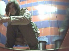 Voyeur films girls pissing in public toilet