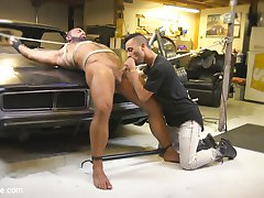 Hairy beefcake Steven Roman finishes up his work in the auto-shop before checking on the store...
