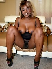 Ebony chick Coco Pink flaunts her humongous titties and takes in a hard dong in her hairy pussy