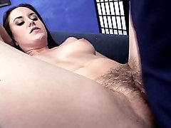 Hairy babe Lea Stevenson layed on her back in a sofa getting banged by a huge dick in her ass