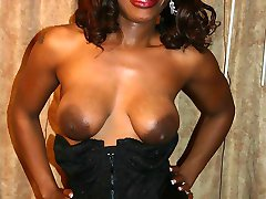 Ebony Brandi Coxxx showing off her big tits and massive butt before she gets cock plugged in her...