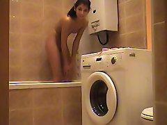 Nude chick caught on bathroom hidden cam