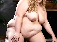 Giant Christina Curves sucks her trusty sex toy before burying it deep inside her velvety smooth...