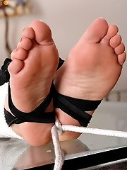 Tied up feet licked