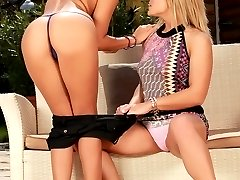 Sultry teen vixens strip and finger