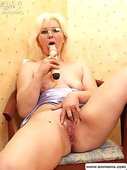 Blonde mature teacher with big tits masturbating with huge dildo