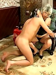 Sultry mature chick treating a guy like her submissive and dirty sex toy