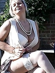 Big breasted mature slut playing in the garden