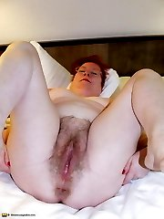 Naughty mature slut playing on her bed