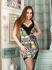 Busty mature babe Sophia Delane naked in black stockings.