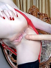 Funky gal in black stockings with a red girdle uses a rubber cock for anal