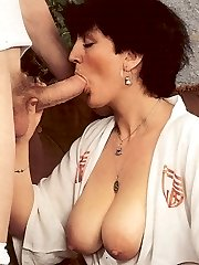 Two retro ladies share cock