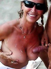 Horny nudists sucking cocks in public