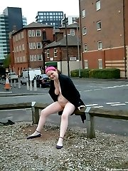 Hot fatty takes off her clothes and poses nude in the street