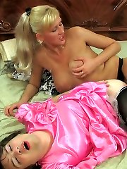Strap-on armed chick and a dolled up sissy ideally match for backdoor work