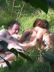 Spy camera movies of outdoor group sex