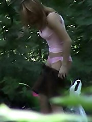 Outdoor spy camera movies of a dressing chick
