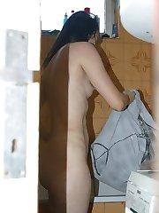 Voyeur pics of an unknowing brunette showering