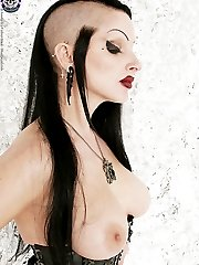 Topless Gothic fetish queen in leather and rubber