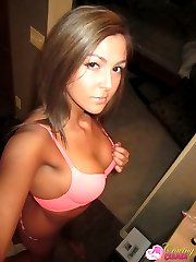 Tanned Craving Carmen takes self shot candid pictures of her perky tits and perfect pussy