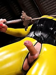 Sultry shemale in yellow latex