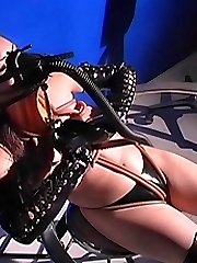 Slave girl in rubber pants and latex boots is submitted to a breath control session