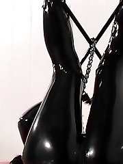 Brunette slave in latex gets gagged then cuffed and left alone in bondage
