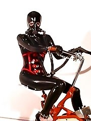 Brunette slave girl in latex, being chained, gets a breath control session
