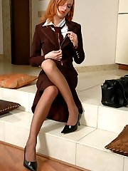 Sultry business lady in luxury pantyhose getting kicks from foot workout