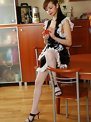 Horny French maid in funky uniform and white stockings stuffing a sex toy