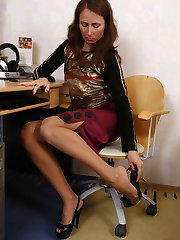 Frisky gal in suntan pantyhose using various objects in sizzling foot games