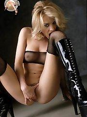 Blonde pornstar Nicolete in latex heels and fishnet stocking fetish toying pussy