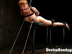 Stunning red headed Marie McCray submits to the skilled hands of well known DeviceBondage...