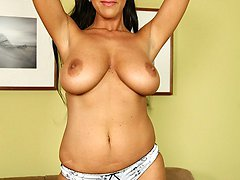 Busty mature babe Christina Ventura rubbing hairy pussy.