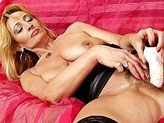 Mature redhead sticks dildo up her hairy pussy