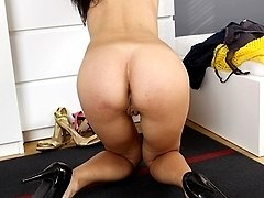 Brunette MILF Erica Fox fingers her wet pussy.