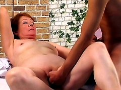 Horny grandma lets a stud finger fuck her cunt