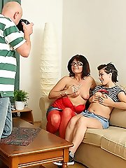 He snaps hot pictures as his wife and his sons girlfriend eat pussy together in the living room