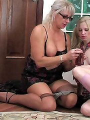 Oversexed mom gets into a schoolgirls pants for fingering and dildo toying