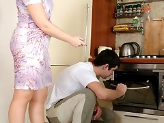 Hot milf teasing a guy with her upskirt look getting packed in the kitchen