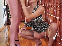 Doll-faced babe whips out a strapon cock ready to drill a wet mature pussy